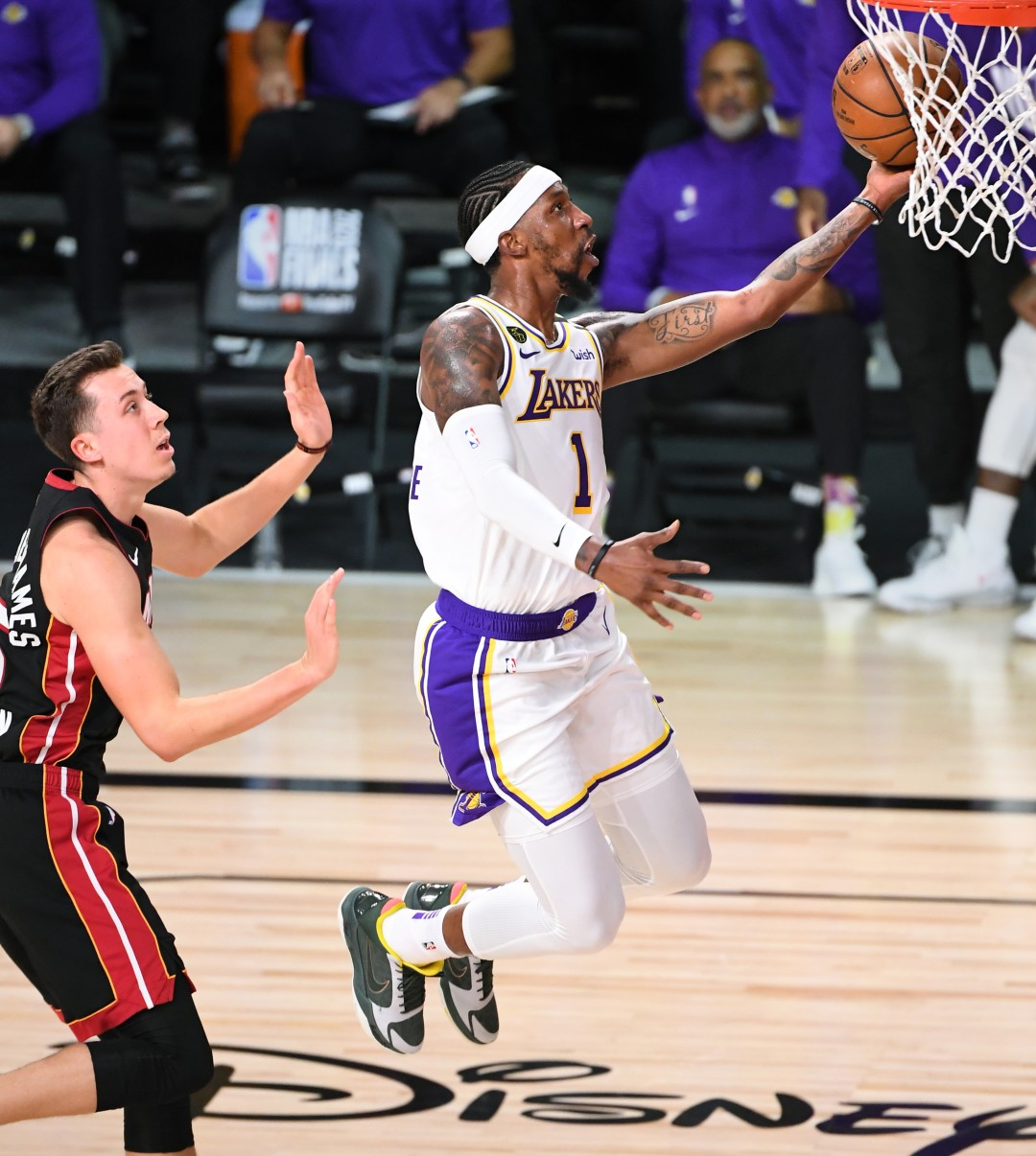 Lakers guard Kentavious Caldwell-Pope scores ahead of Miami Heat guard Duncan Robinson during the first quarter of Game 6 of the NBA Finals on Sunday.(Wally Skalij / Los Angeles Times)