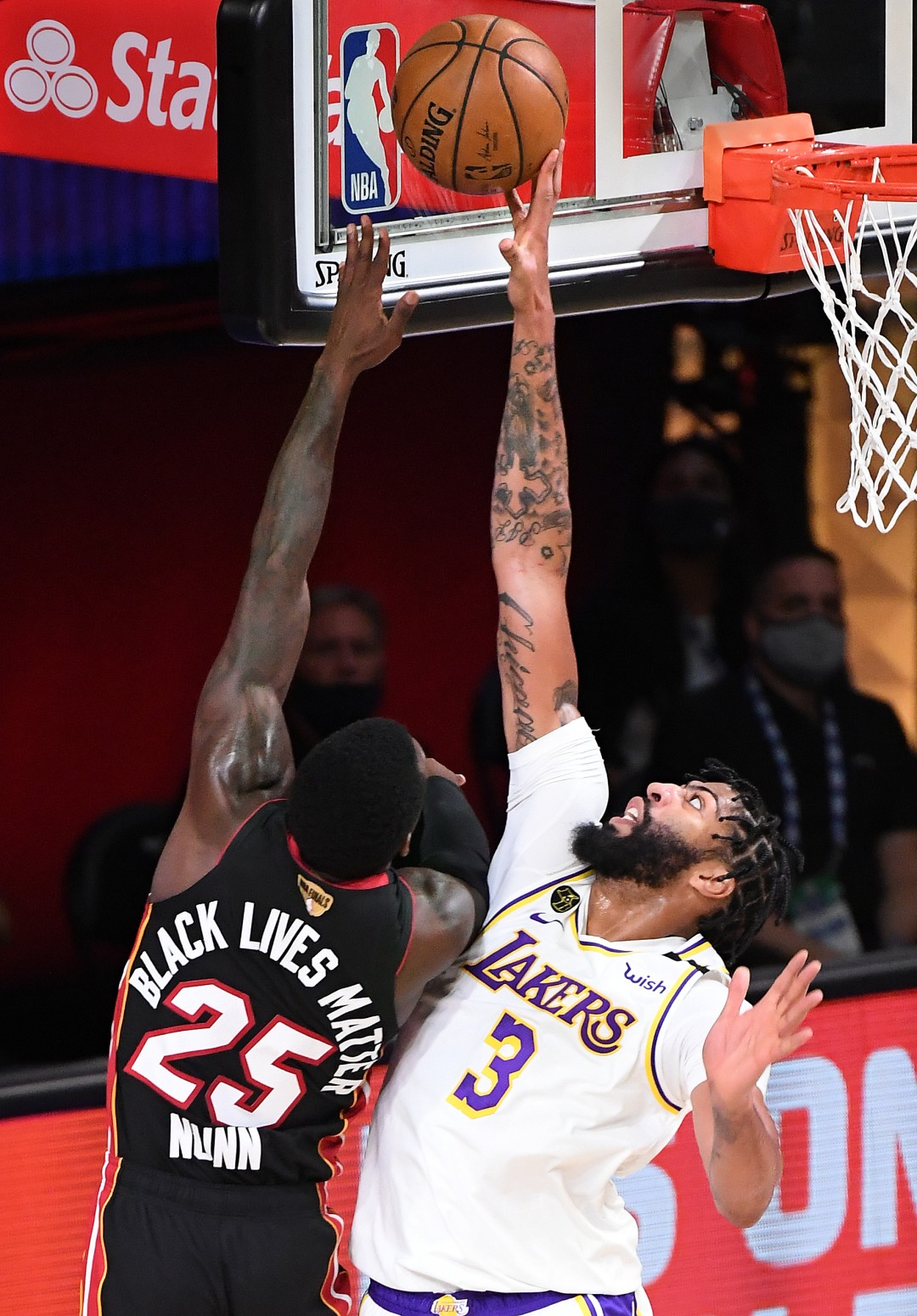 Lakers forward Anthony Davis blocks a shot by Miami Heat guard Kendrick Nunn during the second quarter of Game 6 of the NBA Finals on Sunday.(Wally Skalij / Los Angeles Times)