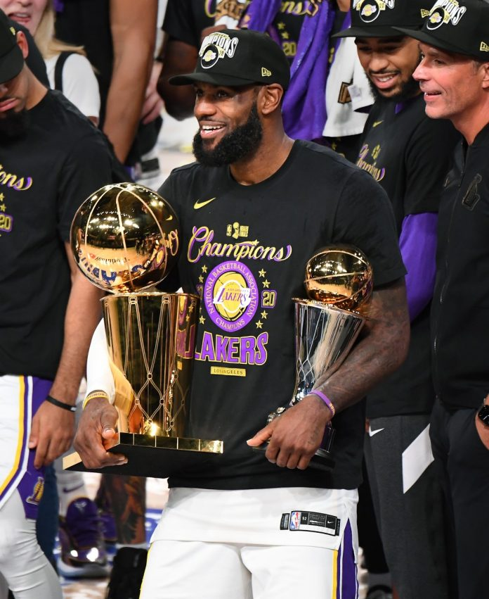 LeBron James holds the MVP and Larry O'Brien trophies after the Lakers defeated the Miami Heat to win the NBA title on Sunday.(Wally Skalij / Los Angeles Times)