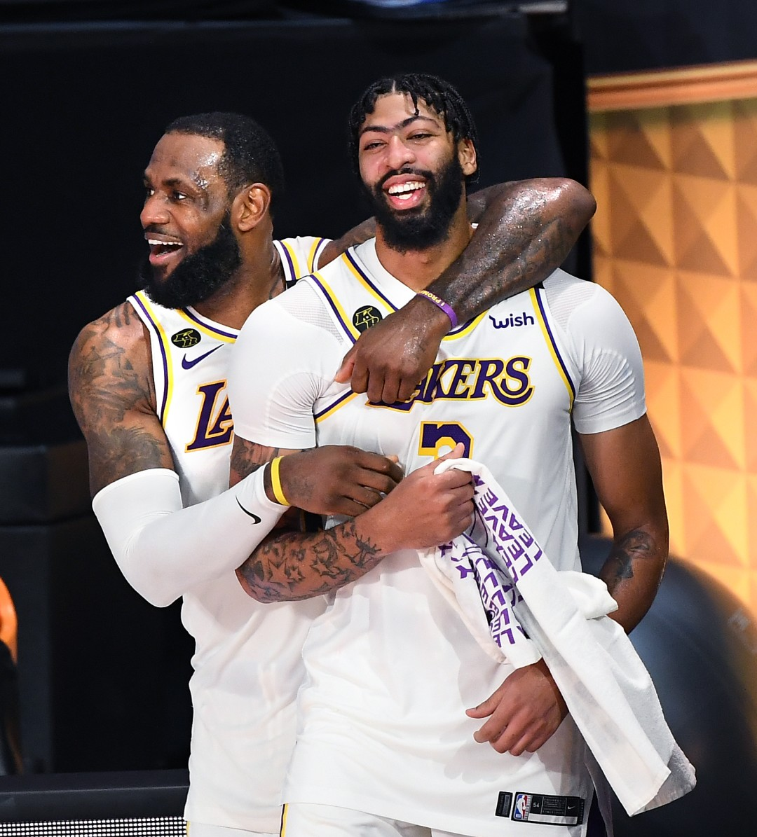 LeBron James, left, and Anthony Davis celebrate in the closing moments of Game 6 of the NBA Finals as the Lakers win their 17th championship.
