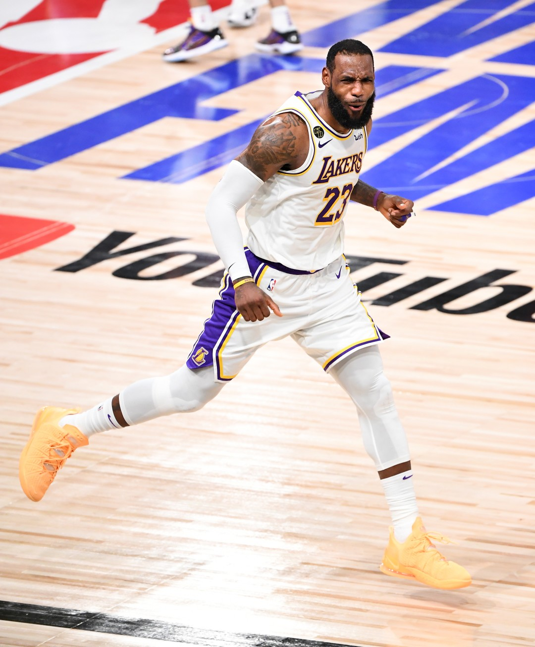 Lakers forward LeBron James celebrates a three-pointer against the Miami Heat in Game 6 of the NBA Finals on Sunday.