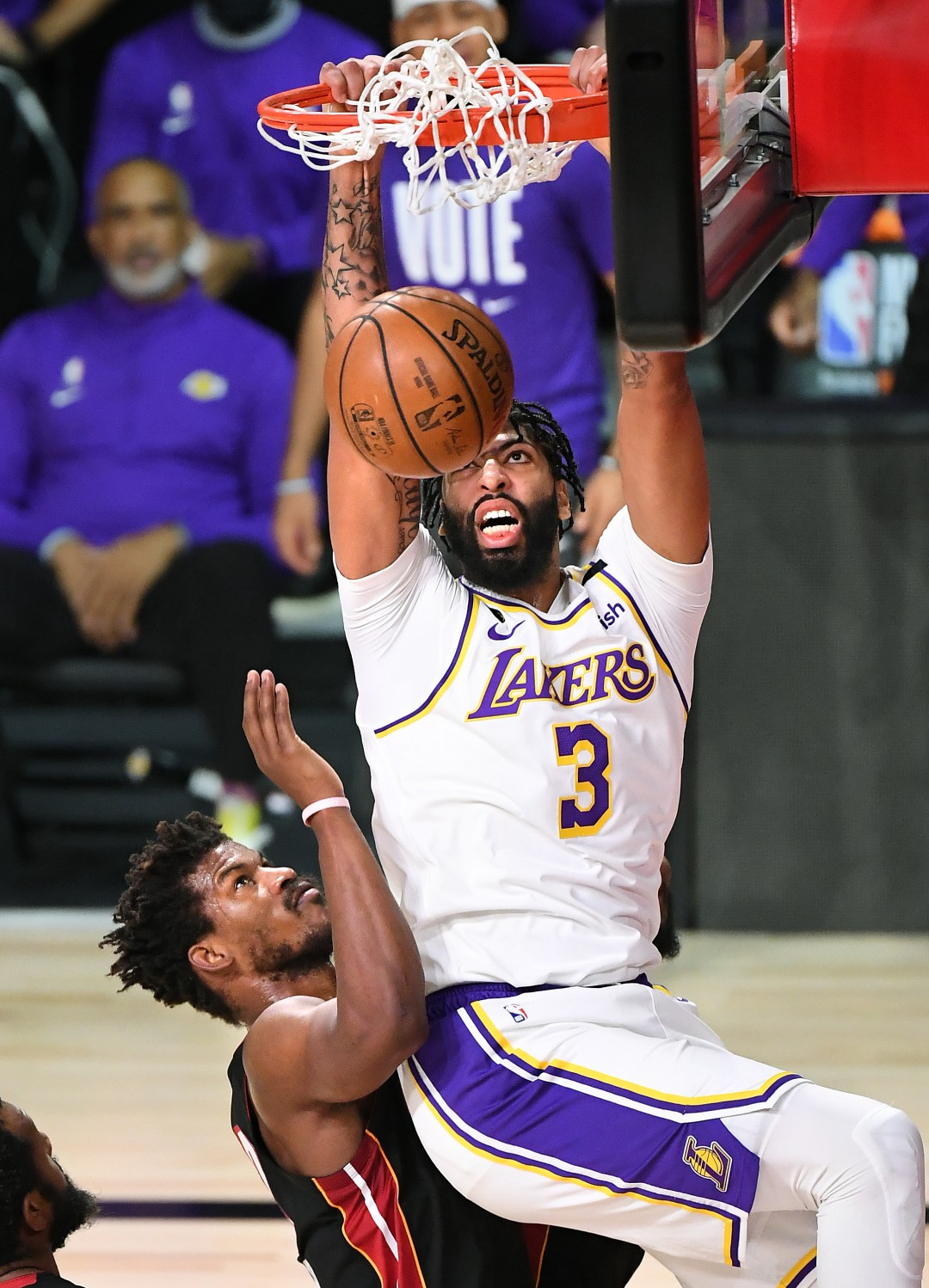 Lakers forward Anthony Davis dunks over Miami Heat forward Jimmy Butler in the first quarter of Game 6 of the NBA Finals.(Wally Skalij / Los Angeles Times)