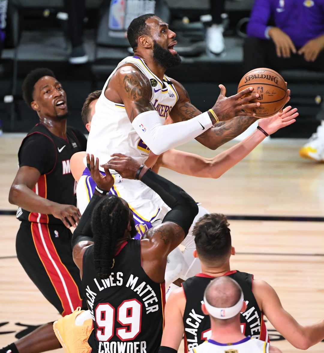 Lakers forward LeBron James puts up a shot over the Miami Heat during the first quarter in Game 6 of the NBA Finals on Sunday.(Wally Skalij / Los Angeles Times)